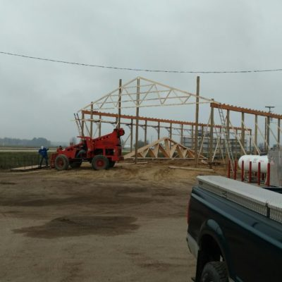 The frame begins to take shape and the first truss is secured into position!