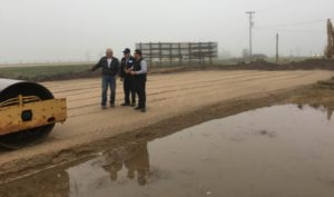 Ed and Tim Alt planning with Mark Kuperus, and discuss all the recent rain that has fallen on the job site in the past week