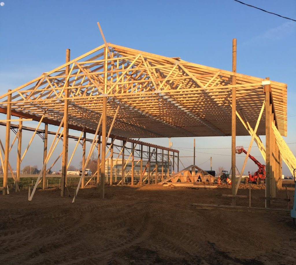 Support posts are in and trusses are up! Finally, it is beginning to take shape and resemble a building!