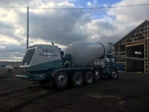 Taking advantage of the mild weather to lay some concrete for the new building!