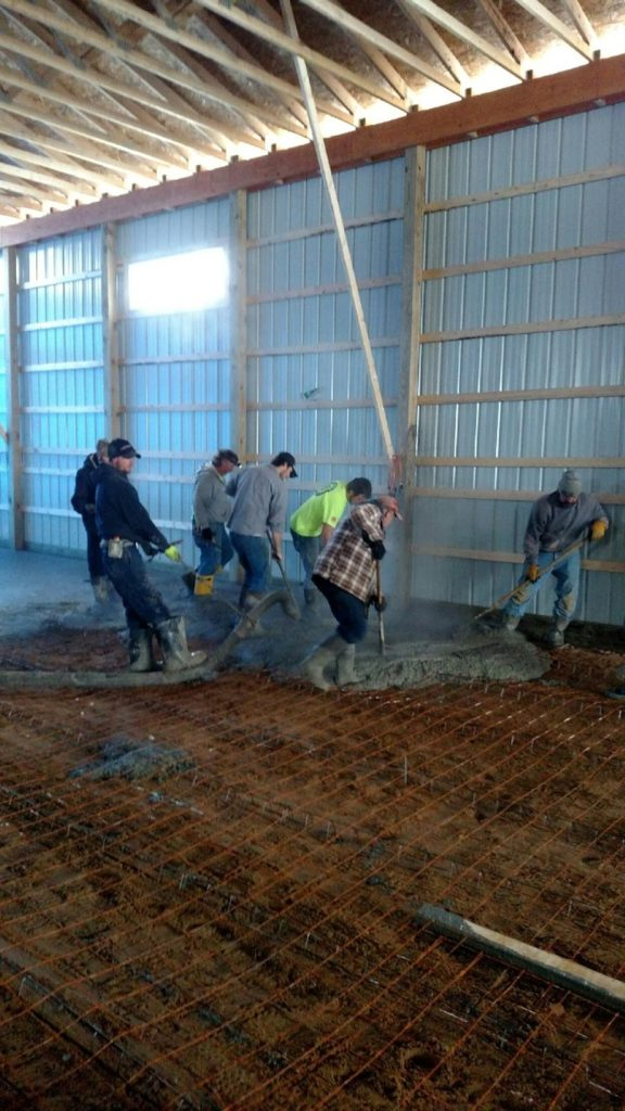 Mark Wright, along with Alt Oil employees and builders from Coopersville Construction, all come together in an attempt to beat mother nature and install the concrete slab floor on a cold Michigan winter day.