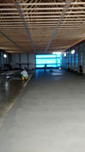 Concrete has been poured and as finishing touches are being applied, it is beginning to look like a floor!