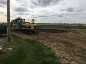 Site ground prep work underway for the new building at Alt Oil Company in Coopersville, MI.