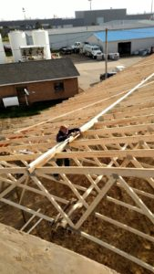 Duckie putting on some finishing touches on the trusses for Alt Oil Company's new building in Coopersville, MI.
